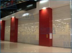 Рулонные перфорированные ворота для ТЦ, бутиков, стоянок, офисов